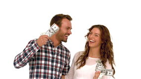 Happy couple waving money. On white screen stock video footage