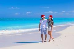 Happy couple wearing Santa hat at caribbean beach Stock Photography