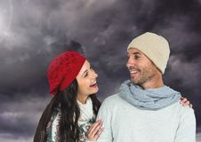 Happy couple wearing warm clothes and looking at each other Stock Photo