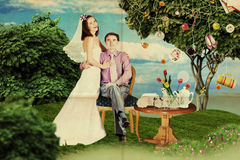 Happy couple in wedding day in park Royalty Free Stock Image