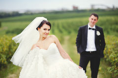 Happy couple on wedding day. In summer field Stock Photos