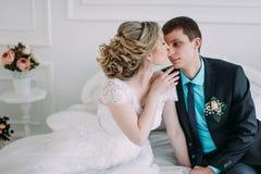 Happy couple. Wedding photo shoot in the white studio with wedding decor kisses, hugs Royalty Free Stock Photography
