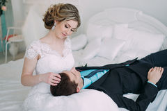 Happy couple. Wedding photo shoot in the white studio with wedding decor kisses, hugs Stock Photography