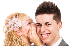 Happy couple whispering Stock Photography