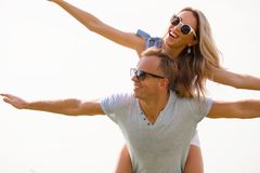 Happy couple with wide arms flying in air. Couple falling in love Stock Photos