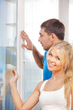 Happy couple at the window Royalty Free Stock Image