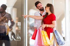 Happy Couple window Shopping Together And Having Fun royalty free stock photography