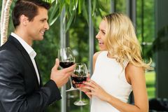 Happy couple with wine glasses Stock Images