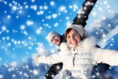 Happy  couple on a winter background Royalty Free Stock Photos