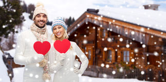 Happy couple in winter clothes with heart outdoors Royalty Free Stock Photo