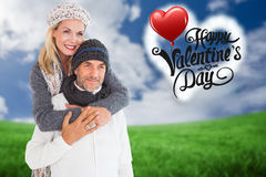 Happy couple in winter fashion embracing Stock Images
