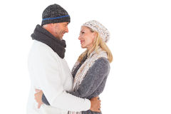 Happy couple in winter fashion embracing Stock Image