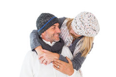 Happy couple in winter fashion embracing Royalty Free Stock Image