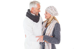 Happy couple in winter fashion embracing Stock Photo