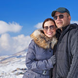 Happy couple in winter mountains Royalty Free Stock Photography