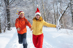 Happy couple  in winter park Royalty Free Stock Images
