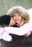 Happy couple in winter park Stock Photography
