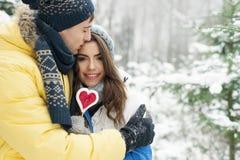 Happy couple in winter stock photos