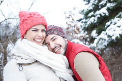 Happy couple in winter in snow Royalty Free Stock Photo