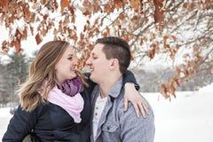 Happy couple winter vacation Stock Photos