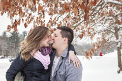 Happy couple winter vacation stock images