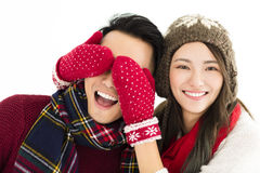 Happy couple in winter wear and covering eyes to surprised Stock Image