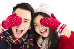 Happy couple in winter wear and covering eyes to surprised royalty free stock photos