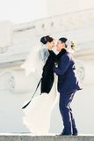 A happy couple in winter wedding day Royalty Free Stock Photos