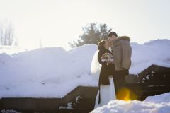A happy couple in winter wedding day Royalty Free Stock Photo