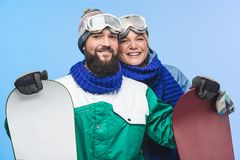 Happy couple wit snowboards Royalty Free Stock Image