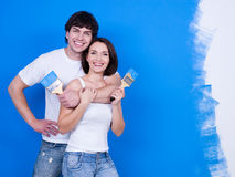 Happy Couple With Paintbrushes Royalty Free Stock Photography