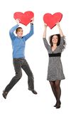 Happy Couple With Red Hearts Royalty Free Stock Image