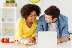 Free Happy Couple With Tablet Pc Cooking Food At Home Stock Image - 94023791