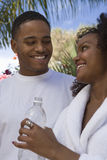 Happy Couple With Woman Holding Water Bottle Stock Photo