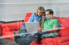 Happy couple work on laptop at home Royalty Free Stock Photography