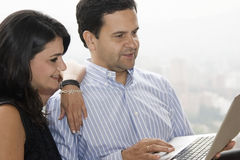 Happy couple working at home Royalty Free Stock Photography