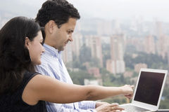 Happy couple working at home Stock Images