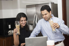 Happy couple working in kitchen Stock Photo