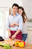 Happy Couple Working In Kitchen Royalty Free Stock Photography