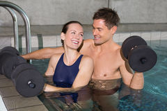 Happy couple working out with foam dumbbells Royalty Free Stock Photo