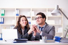 The happy couple working in the same office. Happy couple working in the same office Royalty Free Stock Photos