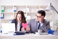 The happy couple working in the same office. Happy couple working in the same office Stock Image