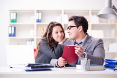 The happy couple working in the same office. Happy couple working in the same office Royalty Free Stock Image