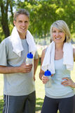 Happy couple after a workout in park Royalty Free Stock Images