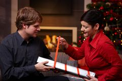 Happy couple wrapping christmas presents Stock Image
