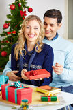 Happy couple wrapping gifts for christmas Stock Images