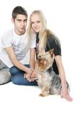 Happy couple with yorkshire terrier over white Stock Photos