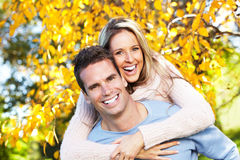Happy couple. Happy young couple in love at the park Royalty Free Stock Photography