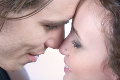 Happy couple - young lovers. Close up of a happy loving couple Royalty Free Stock Photos