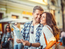 Happy couple. Young couple with a map in the city stock photography